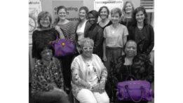 ywca-board-with-purple-purse