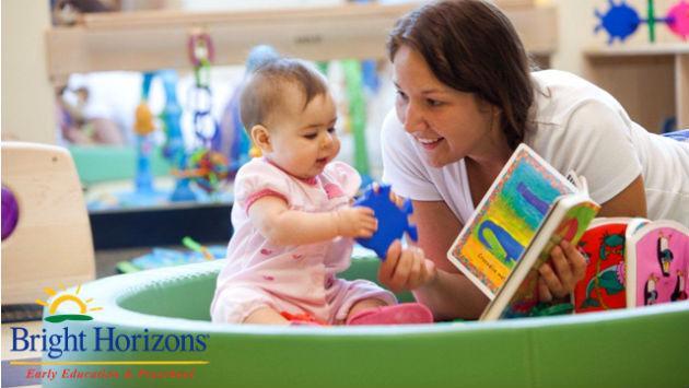 teacher-baby-reading-with-logo