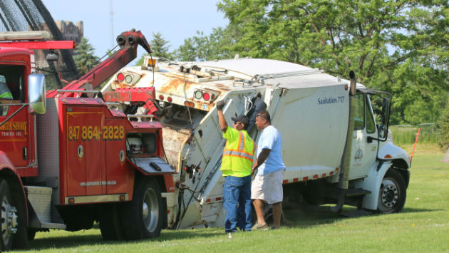 trash-truck-sink-hole-160612-img_9615